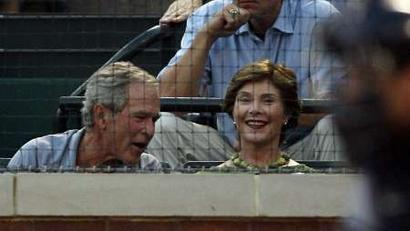 George Bush takes in Rangers action with doll