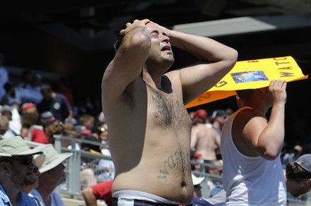 Shirtless sports fan